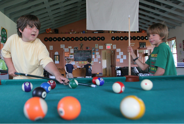 Sam, 9 and Matthew, 9, play a game of pool during the YMCA summer kids program at the Ben Beyea Center in Rockport yesterday. Photo by Maria Uminski/ Gloucester Daily Times
