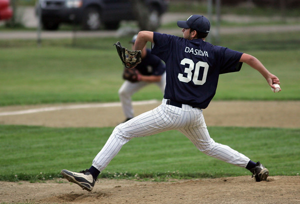 Essex: Manchester Mariners' Lucas Dasilva starts the third Intertown League Baseball Championship game against the Rockport Townies last night. Photo by Maria Uminski/Gloucester Daily Times Wednesday, August 12, 2009