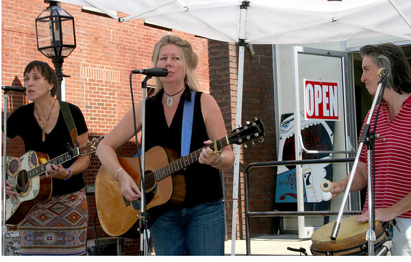 Gloucester: Deb Hardy, left, Alyce Underhill, Kerry Mullen, right, perform in front of Mistery Train shop at Gloucester Sidewalk Days on Saturday. <br /> Photo by Silvie Lockerova/Gloucester Daily Times