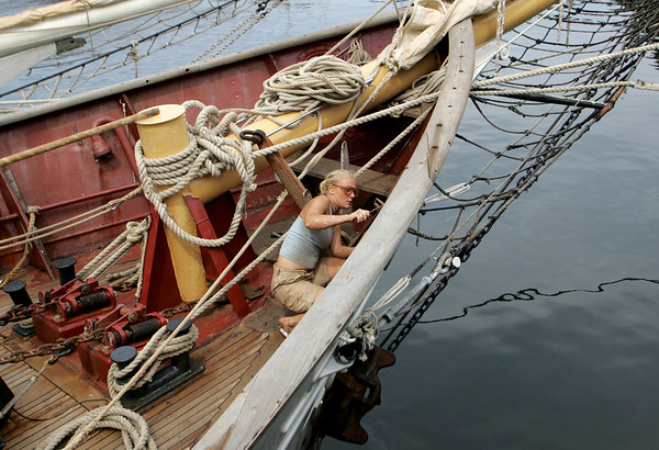 Gloucester: Val Anderson chips rust aboard the Westward schooner at the Jodrey State Fish Pier Friday afternoon. The Westward along with the Spirit of Boston has arrived in Gloucester for repairs. Mary Muckenhoupt/Gloucester Daily Times