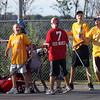 Gloucester: Joe Ogonowsky, left, Jackson Melvin, center, and Anthony Ciaramitaro, right, yell as they score the first goal of their 10-3 loss to the Red Wings during the last regular season game in the Young Legends Street Hockey League at Stage Fort Park last night. Photo by Kate Glass/Gloucester Daily Times Friday, August 7, 2009