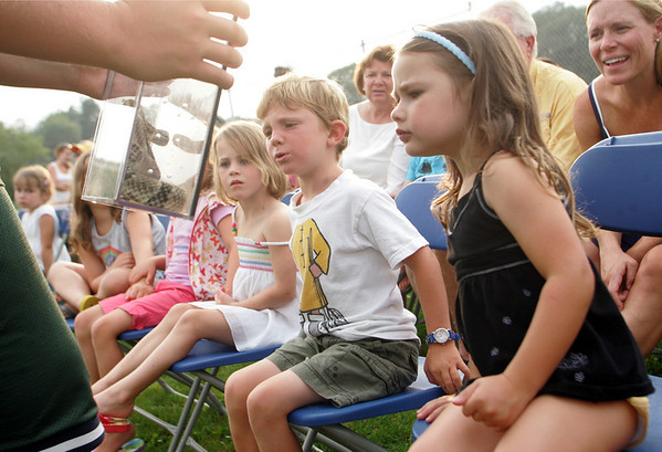 Essex: From left, Grace Gerhardt, 4, Finnegan Lawler, 4, and Syler Corelli, 4, check out a venomous Timer Rattlesnake as Rick Roth presents Snakes of Massachusetts and the World behind TOHP Burnham library Wednesday evening. Mary Muckenhoupt/Gloucester Daily Times