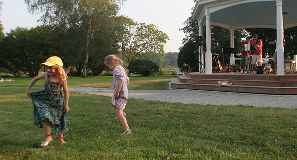 Bella Wright, 4, and Annabel Smith, 4, both of Manchester, dance to the music of Mollie's Misfits on Masconomo Park last night. Mollie's Misfits are one of many acts performing in the Music at Masconomo Park concert series. Photo by Maria Uminski/ Gloucester Daily Times