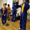 Manchester: Sean Vendt, 5, and Faith Palermo, 9, put on space suits to help aerospace educator Gary Pozzato with demonstrations during a program sponsored by Friends of the Manchester Library yesterday morning. Photo by Kate Glass/Gloucester Daily Times Wednesday, August 12, 2009