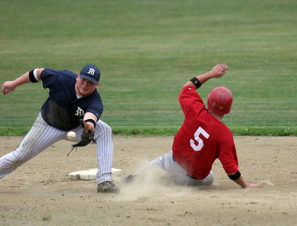 Essex: Manchester Mariners' Nate Bertolino reaches for the ball as Rockport Townies' Chris Bouchie steals second base during the third Intertown League Baseball Championship game last night. Photo by Maria Uminski/Gloucester Daily Times Wednesday, August 12, 2009