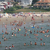 Gloucester: Hundreds of people flocked to the water at Good Harbor Beach yesterday. Water temperatures in New England are the warmest they have ever been, with local temperatures hovering around 70 degrees. Photo by Kate Glass/Gloucester Daily Times Monday, August 17, 2009