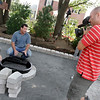 Derek Stearns, left, and Dean Marsico, co-hosts of Indoors Out, explain how they install an outdoor fire pit at Gloucester resident Jamie Marshall's home yesterday. Photo by Kate Glass/Gloucester Daily Times Tuesday, August 4, 2009