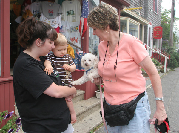 Karen Cleary of Rockport holds up her Poodle, Gigi, for Brandon, 11 month, of Billerica to pet while in Rockport for the day with mom, Sandra. Photo by Maria Uminski/ Gloucester Daily Times
