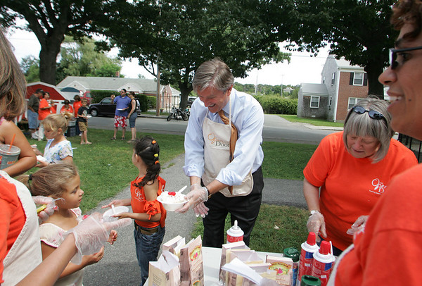 Gloucester: Congressman John Tierney hands out ice cream and frozen yogurt sundeas at the Open Door Summer Lunch Program at Riverdale Park Friday afternoon.  The kids received pizza, yummy dessert and school supplies to celebrate the last lunch of the summer. Mary Muckenhoupt/Gloucester Daily Times