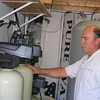 Gloucester: John Knowlton of Pure Water Systems in the Walgreens Plaza says their water is safe because it goes through several stages of filtration to remove contaminants. Photo by Richard Gaines/Gloucester Daily Times Monday, August 24, 2009
