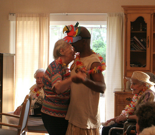 Mike Gifford, activities assistant at the Golden Living Center, dances with resident Pat Casey during Golden Living's Luau yesterday. The pair danced to musical stylings Al Mitchell's Black and White Band. Photo by Maria Uminski/ Gloucester Daily Times