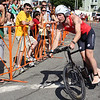 Ethan Brown prepares to dismount his bicycle as he returns to St. Peter's Square. He was the first racer to complete the biking portion of the race. Photo by Jeff Pope/Gloucester Daily Times
