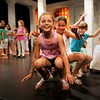 Gloucester: From left, Madolin Beaulieu, 8, front, Clara Mazo, 8, and Sara Wheeler, 8, jumps up and down with their animal team as they pretend to be a frog at the Gloucester Stage Company Friday morning.  The children's class at the Gloucester Stage Youth Acting Workshop run by Heidi Dallin presented their last class for the parents as they showed how well they work as a group as well as on their own with a variety of acting exercises<br />  Mary Muckenhoupt/Gloucester Daily Times