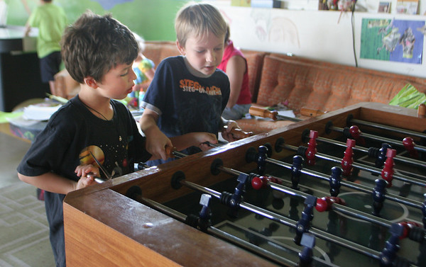 Sam, 6, and Linden, 6, play a game of foosball during the YMCA summer kids program at the Ben Beyea Center in Rockport yesterday. Photo by Maria Uminski/ Gloucester Daily Times