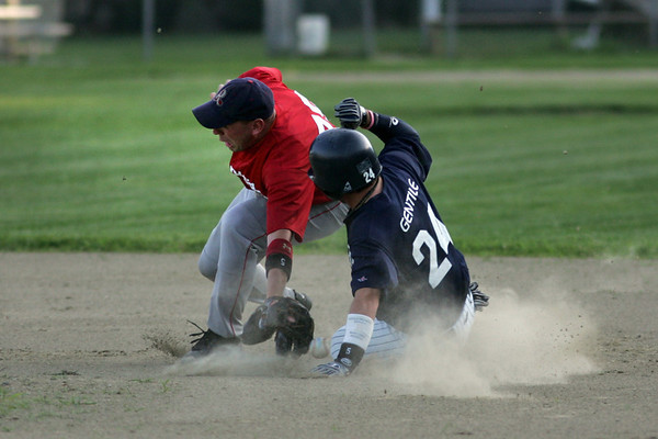 Rockport: Rockport Townies' Jeremy Spittle misses the ball as Manchester Mariners' Rory Gentile steals second base during the second game of the Intertown League Championship last night. Photo by Kate Glass/Gloucester Daily Times Monday, August 10, 2009