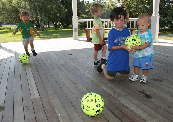 Manchester: Cole Meehan, Michael DeOreo, Ryan Meehan, and Cole Meehan practice their soccer skills inside the gazebo at Masconomo Park after Mini-Soccer Camp Wednesday morning. Photo by Kate Glass/Gloucester Daily Times Wednesday, August 26, 2009