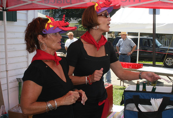 Rockport: Daphne Ped Congeosi, left, and Mary Anne Whited serve wines at the Lobsterfest on Saturday morning<br /> Silvie Lockerova/Gloucester Daily Times