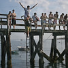 Magnolia: James Patrican, 16, jumps off the pier at Magnolia Beach on the shoulders of his cousin, Dylan Spellman, 15. Silvie Lockerova/Gloucester Daily Times