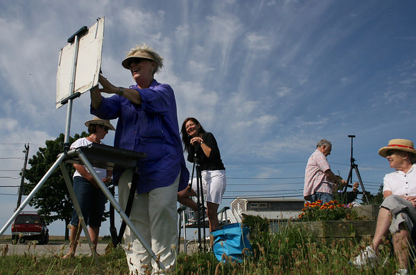 Gloucester: Carole Loiacono from Art Association in Rockport demonstrates water color painting to her students at Rocky Neck in Gloucester Thursday morning. Students joining the class are, from left, Marilyn Russo, left, Robyn Steinberger and Doris Patey.<br /> Silvie Lockerova/Gloucester Daily Times