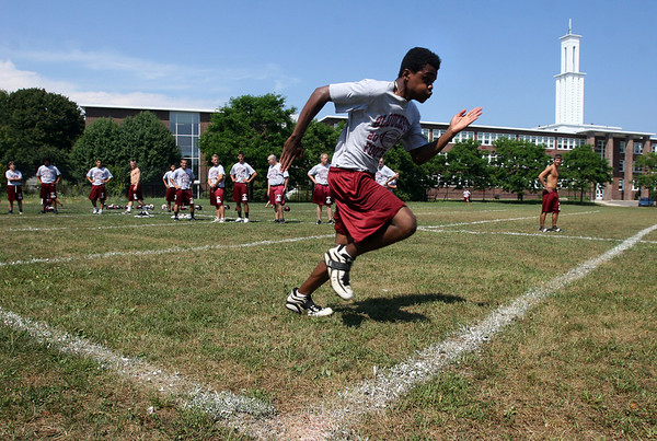 Gloucester: Gloucester senior Flory Kabulo runs a 4.9 forty as his teammates look on during the first day of football practice yesterday. Photo by Kate Glass/Gloucester Daily Times Monday, August 24, 2009
