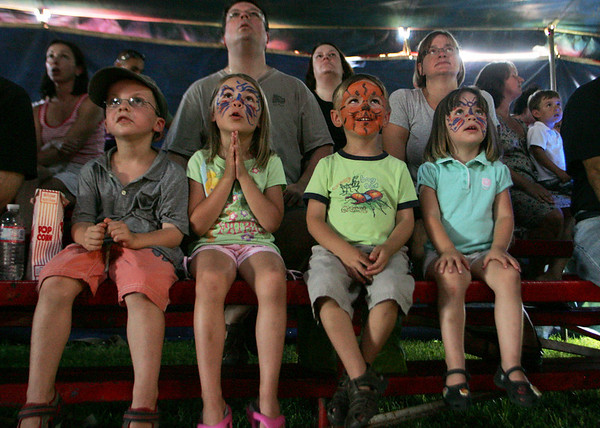 Rockport: From left, Eli Mueller, 5, Julia Drost, 5, Erik Drost, 3, and Anna Drost, 3, all of Rockport watch in amazement as Susan Vidbel-Ashton performs her areial routine at the Vidbel Circus behind Rockport Elementary School Saturday.