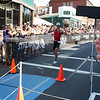 Winner Ethan Brown of Lowell crosses the finish line. Photo by Jeff Pope/Gloucester Daily Times
