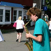 Rockport: Frank Evans plays saxofon at the streets of Bearskinneck in sunny Tuesday afternoon.<br /> Silvie Lockerova/Gloucester Daily Times