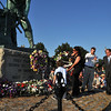 Gloucester: Josie Russo the widow of Matt Russo and her son Saliatore Moses Russo 3, places a wreath at the Fishermen's Statue in memory of her husband Matt Russo and father John Orlando, who lost their lives aboard the Patriot, at the Fishermen's Memorial held Saturday afternoon.Desi Smith Photo/Gloucester Daily Times.August 15,2009.