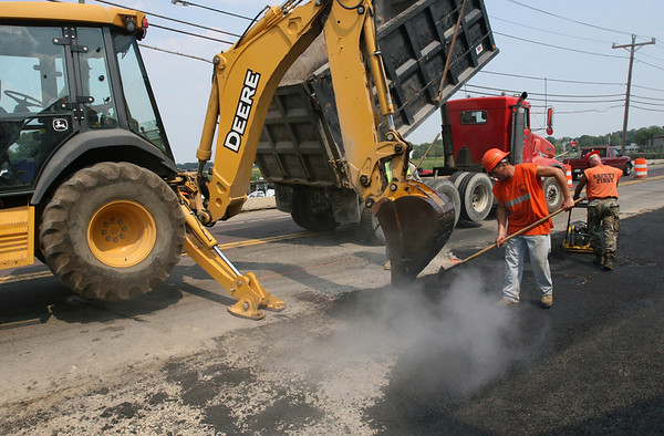 Essex: Cliff Teixeira rakes asphalt along the Causeway in Essex yesterday afternoon in preparation for a temporary widening of the road. Temperatures hovered around 90 degrees, but the crew said work would continue as scheduled. Photo by Kate Glass/Gloucester Daily Times Tuesday, August 18, 2009