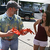 Rockport: Jonas Gavilis and Christina Chalmers, 13, serve lobsters and corn  at the Lobsterfest on Saturday morning.<br /> Silvie Lockerova/Gloucester Daily Times