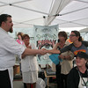 William Fogerty, of the Alchemy Cafe, and Melissa Hart, of Sugar Magnolias, shake hands after a close finish to the Seafood Throwdown at the Cape Ann Farmers' Market. Sugar Magnolias won the throwdown with a score of 36 to 32. Both teams had to incorporate the secret ingredients which were cod and whiting. Photo by Maria Uminski/ Gloucester Daily Times