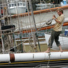 Gloucester: Trevor Tingle works at down rigging the Spirit of Massachusetts in preparation to have the masts pulled on Monday at Jodrey State Fish Pier Friday afternoon. Mary Muckenhoupt/Gloucester Daily Times