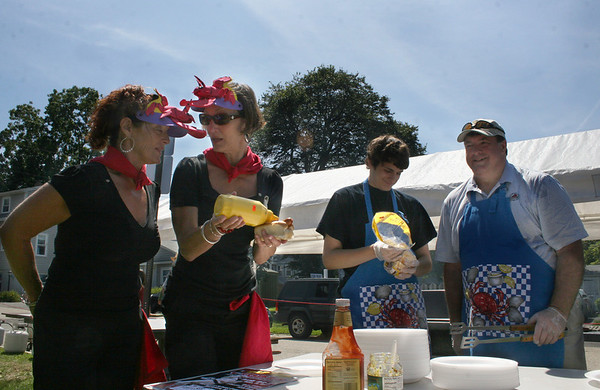 Rockport: Daphne Ped Congeosi, left, Mary Anne Whited, Ryan Adaino and Rob Adaino, right, by a hotdog table at the Lobsterfest on Saturday morning.<br /> Silvie Lockerova/Gloucester Daily Times