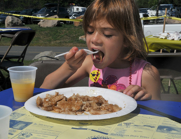 Gloucester: Arianna Mandell 6, from Scotts Valley, California, eats her finely cut pancakes, at the Gloucester Rotary Pancake Breakfast, held at Stage Fort Park Saturday morning. Arianna came to Gloucester to visit with family.Desi Smith Photo/Gloucester Daily Times. August 15,2009