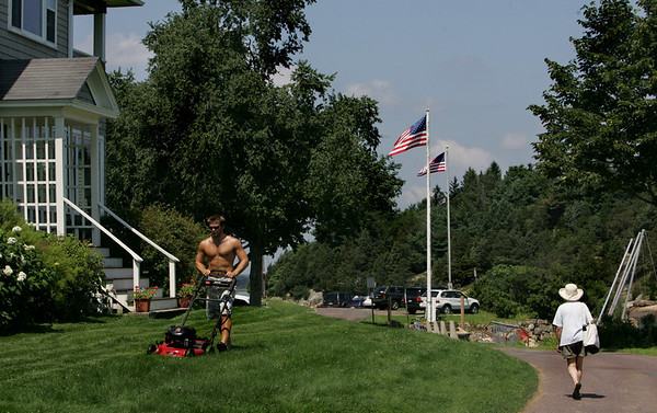 Essex: INFO SHOULD BE ADDED FROM CAM'S STORY. Alec Phillips mows lawns on Conomo Point Saturday. Mary Muckenhoupt/Gloucester Daily Times