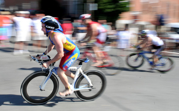 Gloucester: A cyclist races up Western Ave in the 1st Gloucester Triathlon held Sunday morning. Photo by Desi Smith/Gloucester Daily Times