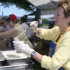Rockport: Anne Lewis, right, sells Clam Chowder soup, Barbara Ellis, middle, and Eleonor Hoy, left serve cooked corn and lobsters at the Lobsterfest on Saturday morning.<br /> Silvie Lockerova/Gloucester Daily Times