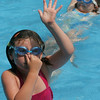 Gloucester: Julia Amero, 6, gets ready to go underwater while swimming with her friends at the YMCA Camp Spindrift Thursday afternoon.  While some campers played kickball or worked on arts and crafts the pool was a hot spot for kids to cool off.  Mary Muckenhoupt/Gloucester Daily Times
