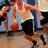 Gloucester: Gloucester Dispatch's Todd Newton dribbles down the court during their game against Flynn Physical Therapy in the Cape Ann YMCA's Summer Basketball League last night. Flynn won the game 99-97. Photo by Kate Glass/Gloucester Daily Times