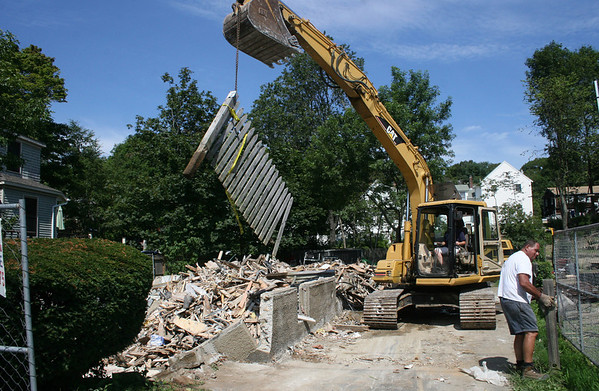 Gloucester: Crews work on demolishing 74 Eastern Avenue, the house that was next to Wayne Sargent's home which exploded last January. <br /> Silvie Lockerova/Gloucester Daily Times