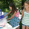 Rockport: Anna Catena, left, and Emma Rukeyser, both 10, set up a lemonade stand at the intersection of Summer Street and Jerden's Lane to raise money for Catena's uncle, Tom Catena, who is a doctor in Sudan. Photo by Kate Glass/Gloucester Daily Times Friday, August 7, 2009
