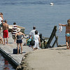 Essex: Madison Lawler, 6, puts her arm around her little brother Finnegan, 4, as they walk down to the dock to go swimming at Conomo Point Saturday morning. Mary Muckenhoupt/Gloucester Daily Times