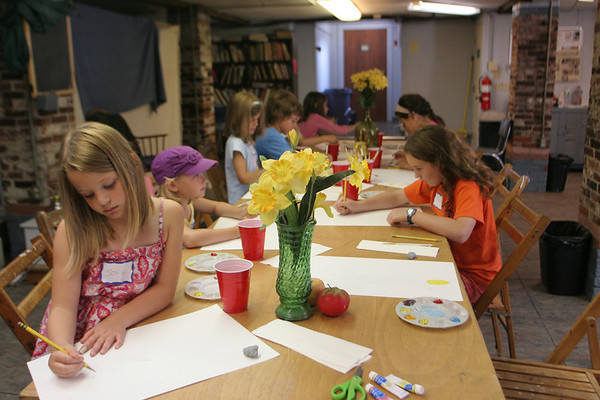 A group of 5-11 year olds are hard at work on their drawings and paintings during a Drawing and Painting Session with Becky Merry at the Rockport Art Association yesterday. Photo by Maria Uminski/ Gloucester Daily Times