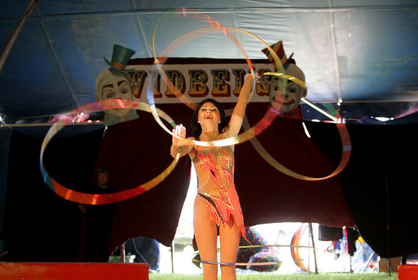 Rockport: A performer juggles hula hoops as part of her routine at Vidbel Circus behind Rockport Elementary School Saturday afternoon. Mary Muckenhoupt/Gloucester Daily Times