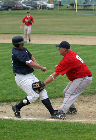 Essex: Manchester Mariners' Rick Bettencourt is safe at first as Rockport Townies' Brent Currier loses the ball during the third Intertown League Baseball Championship game last night. Photo by Maria Uminski/Gloucester Daily Times Wednesday, August 12, 2009