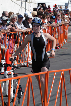 Alicia Kaye of Maynard heads in after finishing the cycling part of the 1st Gloucester Triathlon. Photo by Desi Smith/Gloucester Daily Times