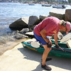 Bill O'Maley sets up his kayak before he sets out from Old Ganite Pier in Rockport, with June Catalina for a afternoon on the water. Photo by Maria Uminski/ Gloucester Daily Times