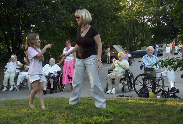 Rockport: Marlene Victorine dances with her daughter, Juliana, 7, at the Den-Mar Rehab and Nursing Center's annual antique car show on Tuesday evening. The event featured cars, food, and music by Al LaBella. Photo by Kate Glass/Gloucester Daily Times Tuesday, August 18, 2009