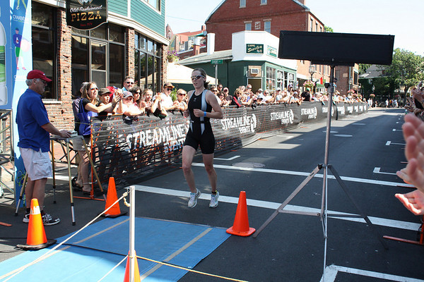 Women's winner Alicia Kaye crosses the finish line. Photo by Jeff Pope/Gloucester Daily Times