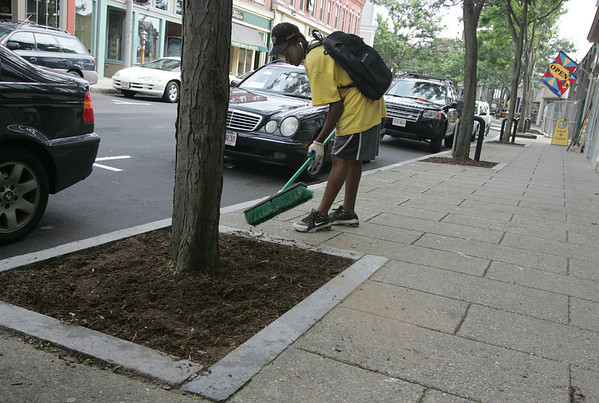 Gloucester: Joey Kabulo of the YMCA's Clean Team, sweeps the sidewalks along Main Street yesterday morning. The crew has been taking care of Main Street all summer and will continue until the end of the month. Photo by Kate Glass/Gloucester Daily Times Tuesday, August 11, 2009
